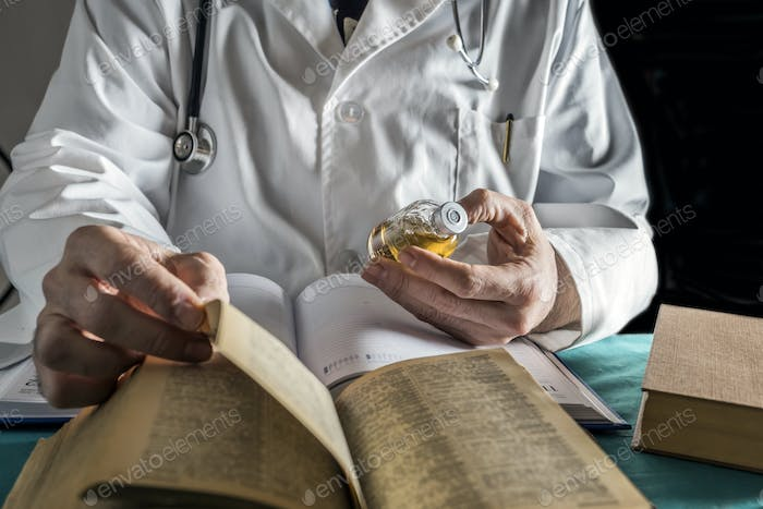 Doctor Reading Book Of Old Medicine, Conceptual Image