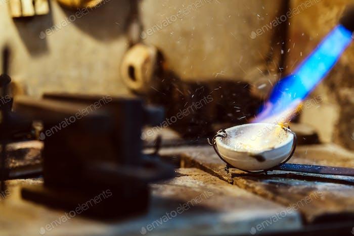Jeweler welding gold