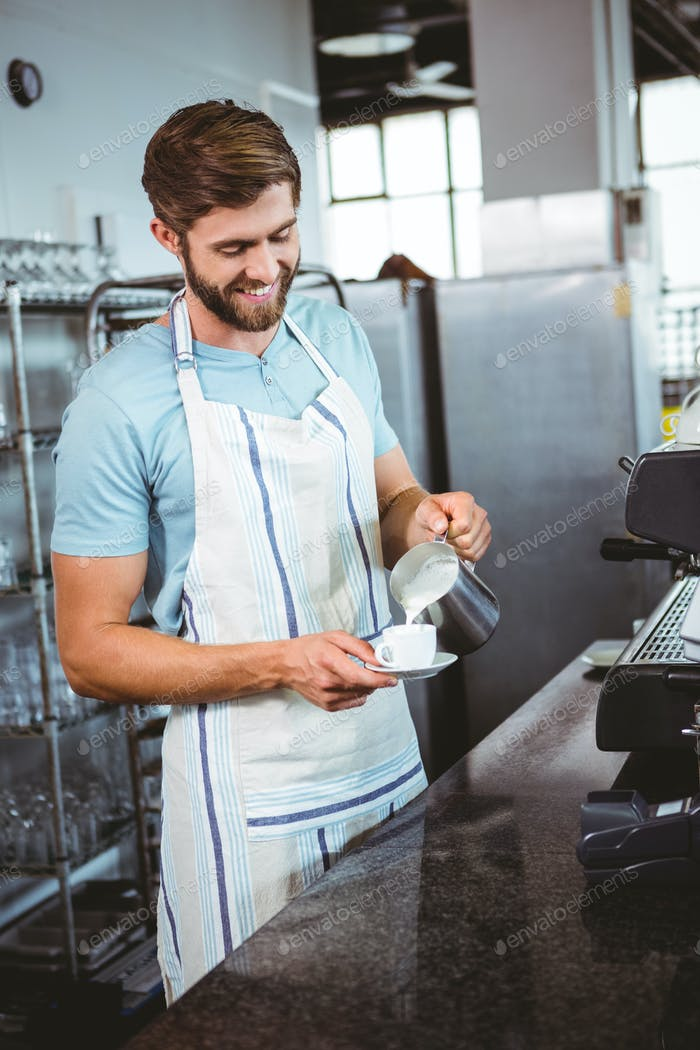 happy worker making coffee in the bakery