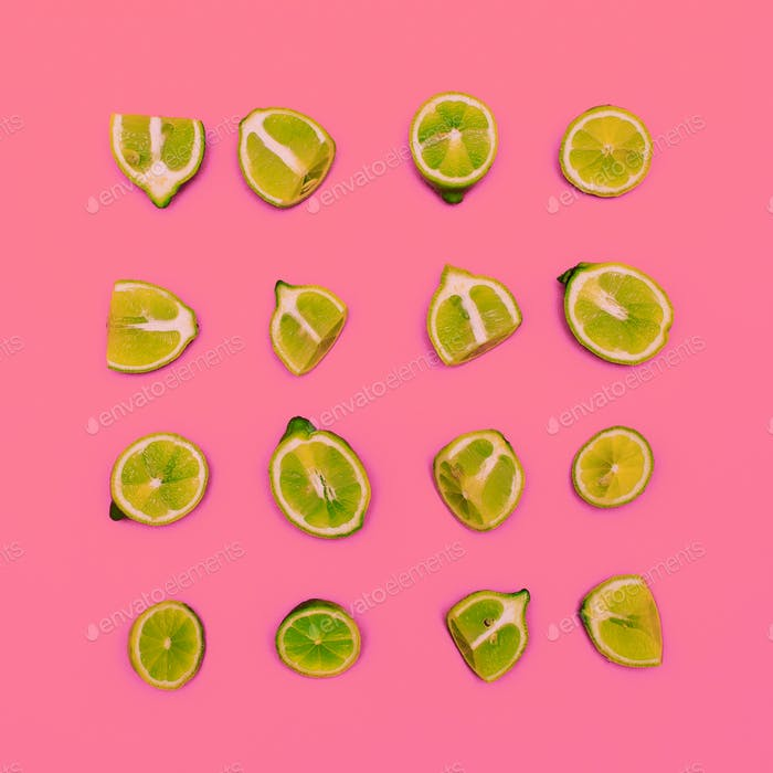 Limes on a pink background. Minimal idea food creative