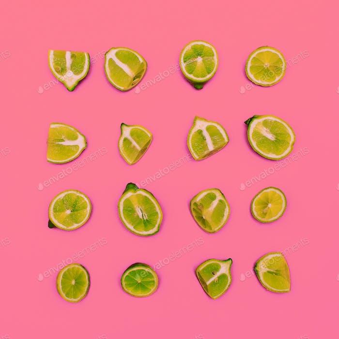 Limes on a pink background. Minimal idea food creative