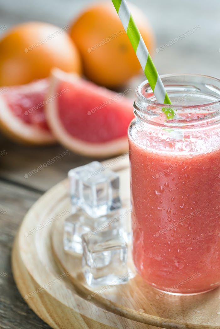 Glass jar of grapefruit smoothie