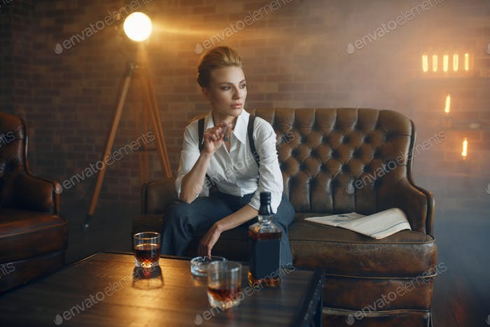 Woman at the table with whiskey, gangster style