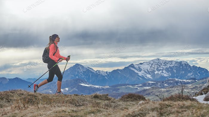 Girl walking alone in the mountains