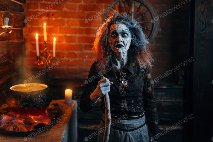 Scary witch on spiritual seance, cooking