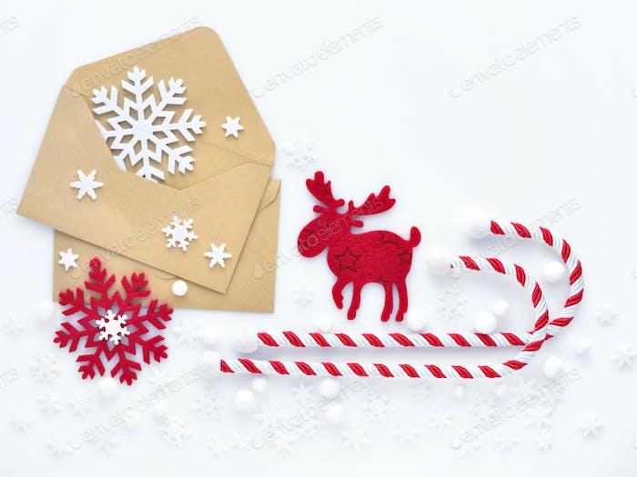 Christmas composition. Envelopes, christmas decorations, snowfla