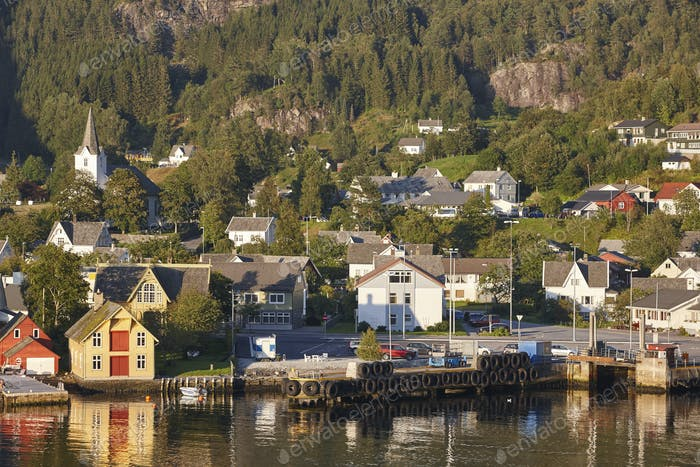 Traditional norwegian fjord village with harbor. Jondal. Hardanger route. Horizontal