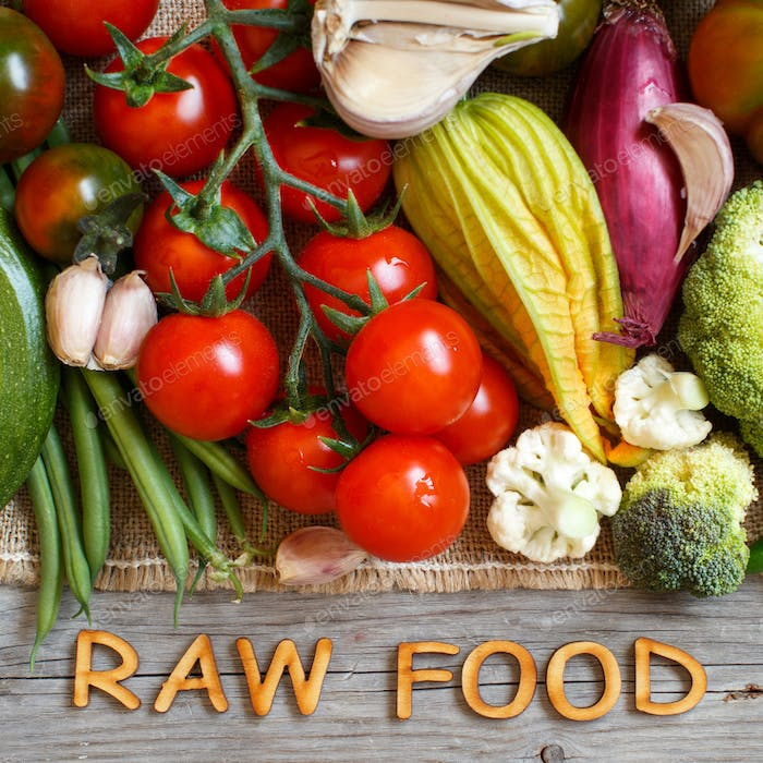 Fresh vegetables and wooden letters RAW FOOD