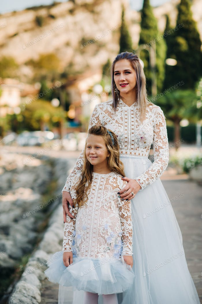 Italy, Lake Garda.Stylish Mother and daughter on the shores of lake Garda in Italy at the foot of