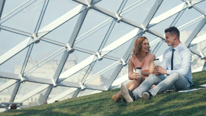 Smiling couple with paper cups