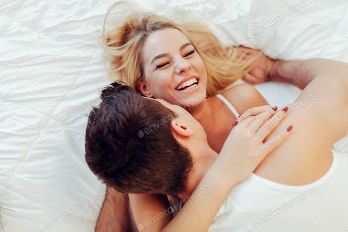 Happy couple in bedroom