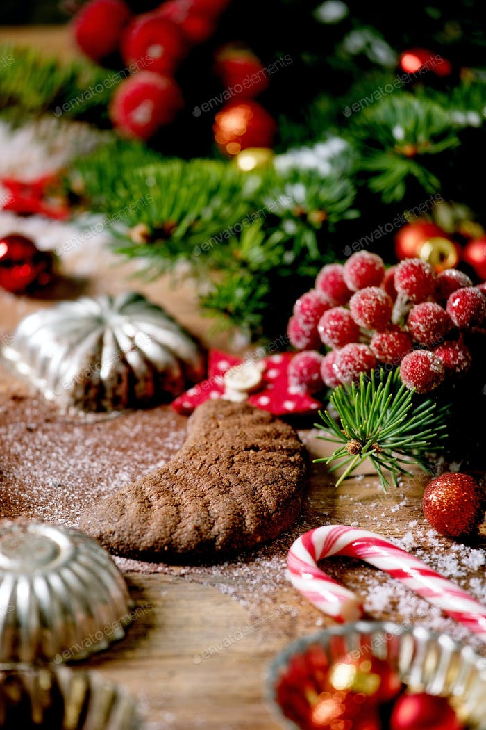 Christmas shortcrust cookies chocolate crescents with fir tree, molds, xmas decorations.