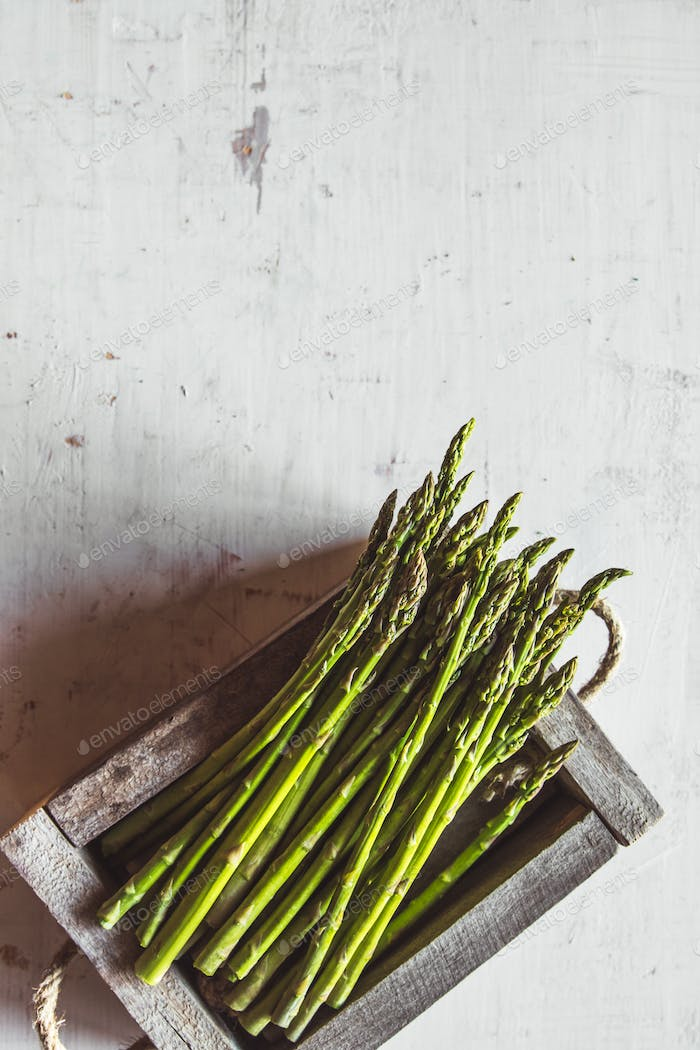 Asparagus in a wooden box, vintage. Healthy food, health