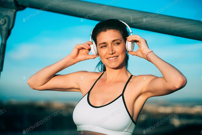 Young fit blonde runner woman resting in the bridge