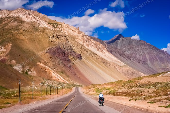 Cycling on the road through south american Andes
