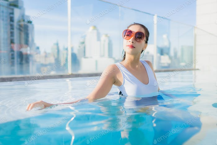 Portrait beautiful young asian woman relax leisure around swimming pool