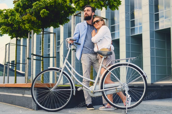 A couple on a date after bicycle ride in a city.