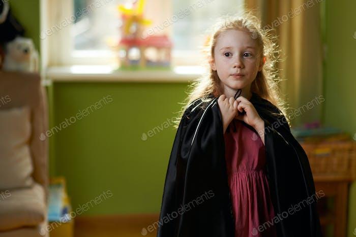 girl dresses black cape