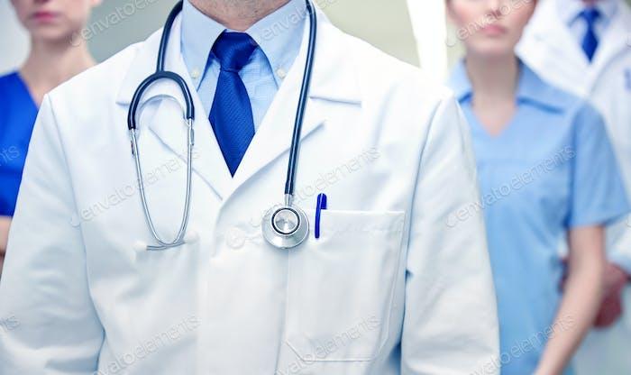 close up of medics or doctors at hospital