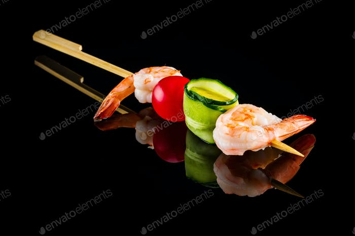 Skewer of shrimps, cucumber and cherry tomato