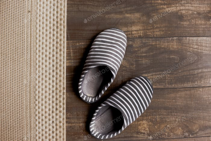 Slippers on the brown parquet floor
