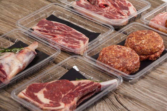 Varieties of meat in plastic boxes