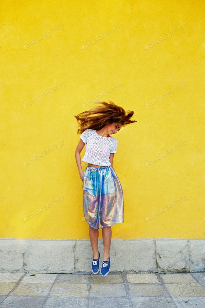 Attractive girl in an unusual skirt