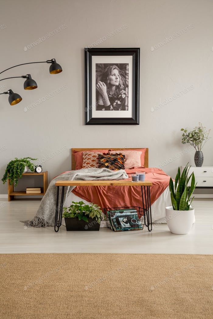 Vertical view of stylish bedroom with king size bed with rust co
