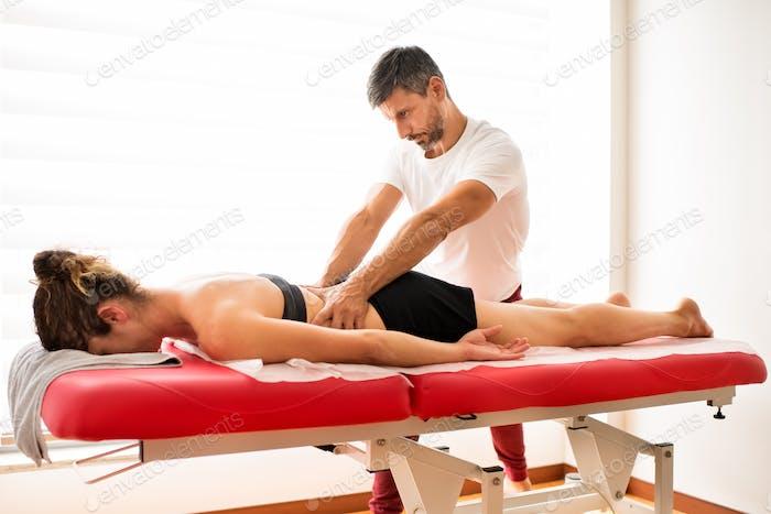 Osteopath doing lumbar myofascial treatment