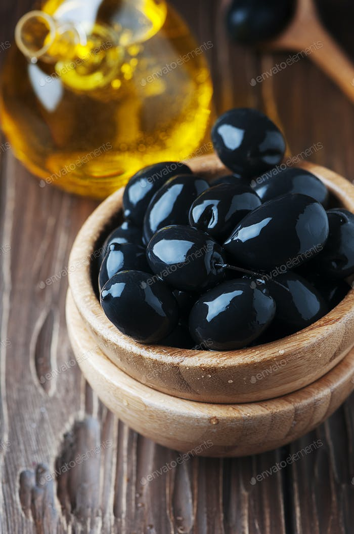 Greek black olive and oil on the wooden table
