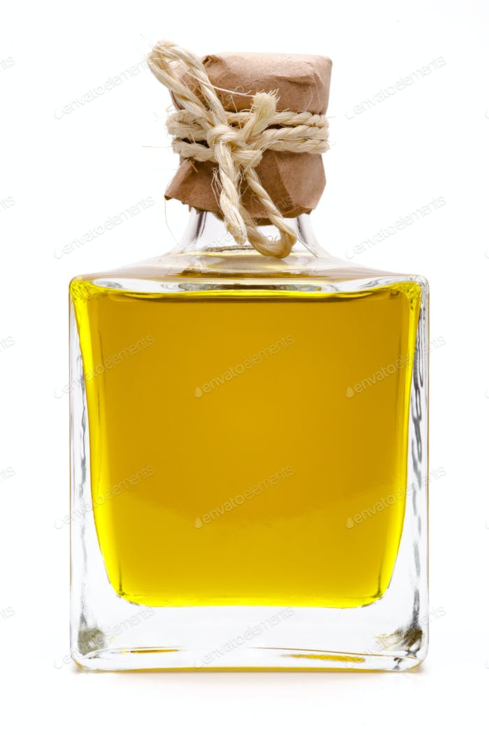 Yellow liquid, olive oil, in a bottle