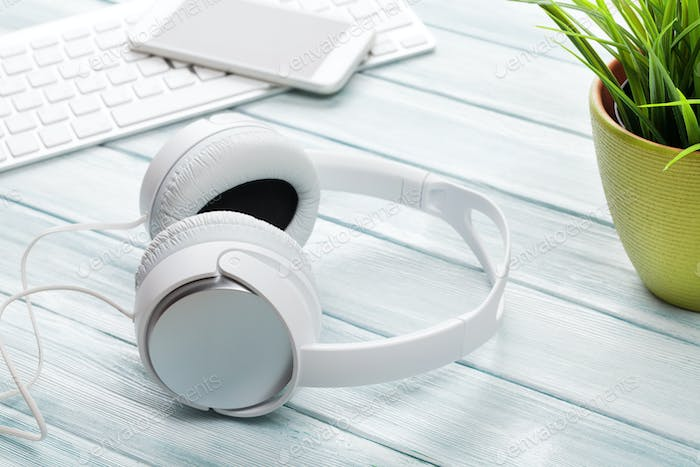 Headphones, notepad and phone