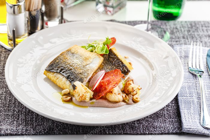 Pike perch fillet in a restaurant serving
