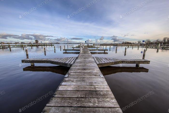 Empty wooden jetty in marina
