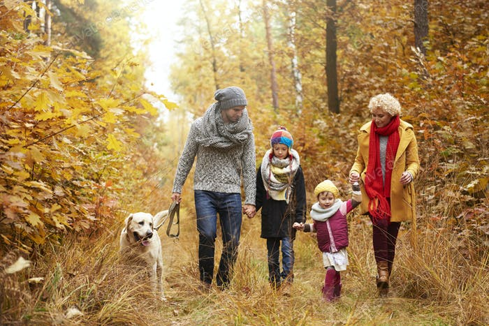 Family and their dog in the woods