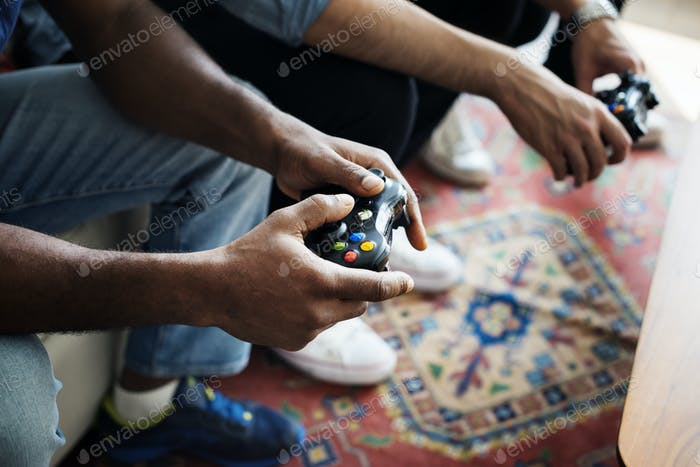 Hands holding a game controller
