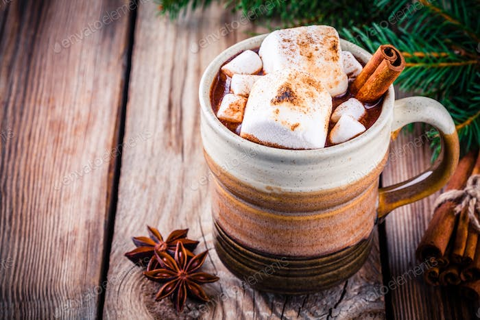 hot chocolate with marshmallows and cinnamon in mug