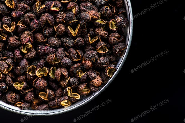 Pot with Timut Nepalese pepper on dark