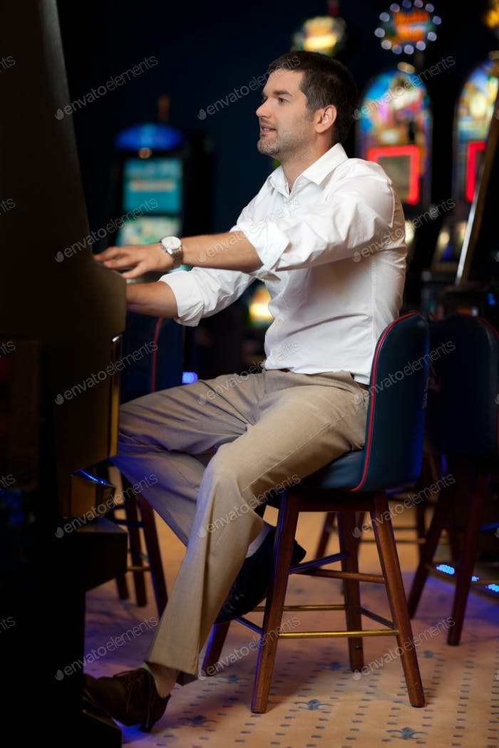 man gambling at slot machine