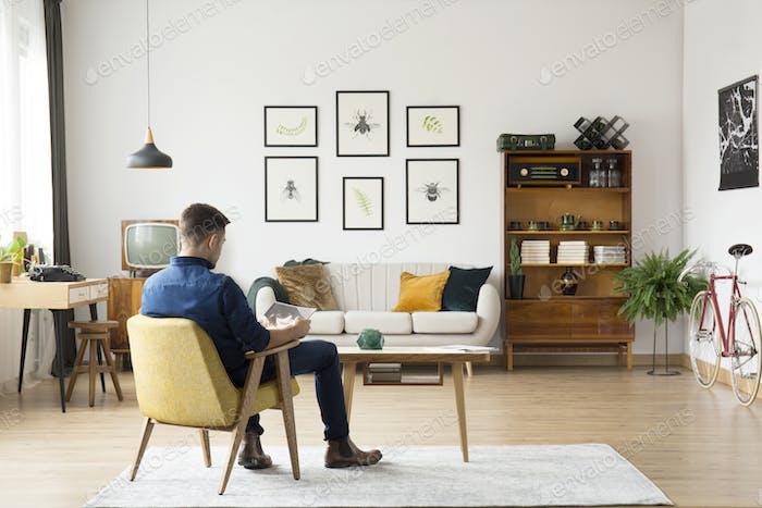 Man in retro living room