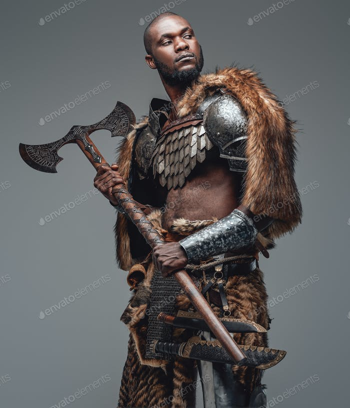 Proud warrior from the past in fur and armour holding a combat axe