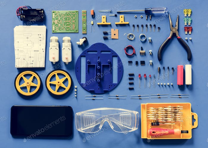 Aerial view of electronics tools equipments on blue background
