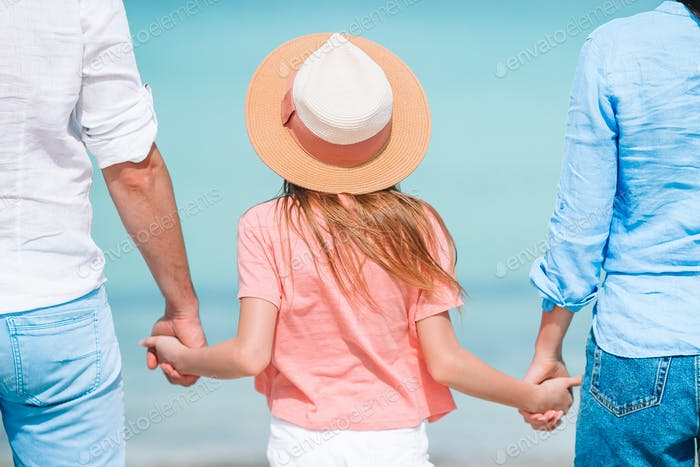 Beautiful tropical beach landscape with family enjoying summer vacation