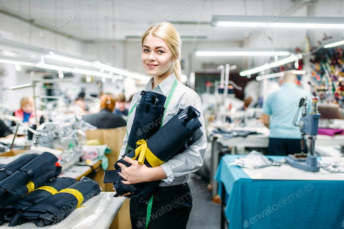 Clothes designer holding fabric textile in hands