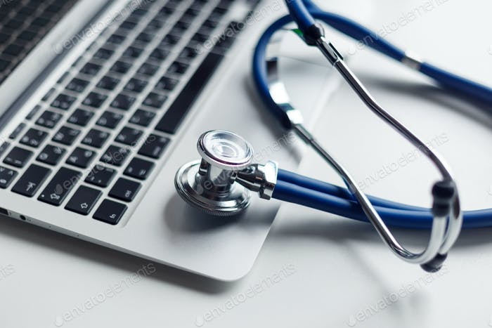 Stethoscope on laptop keyboard. Medicine concept