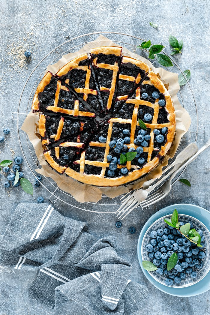 Traditional homemade american blueberry pie with lattice pastry, top view