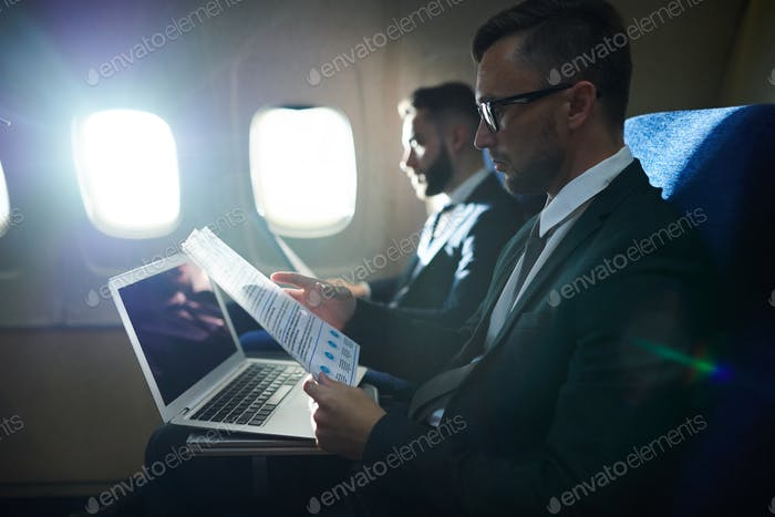Row of Business People in Plane