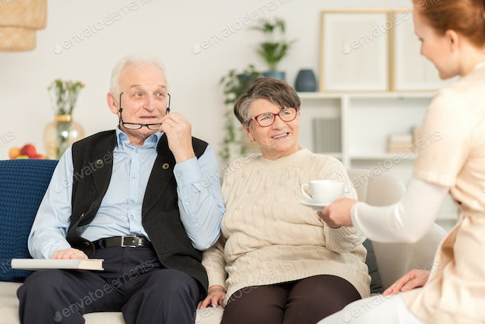 Elderly couple and nurse
