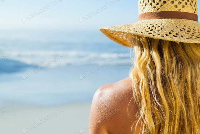 Gorgeous blonde in sunhat on the beach on a sunny day