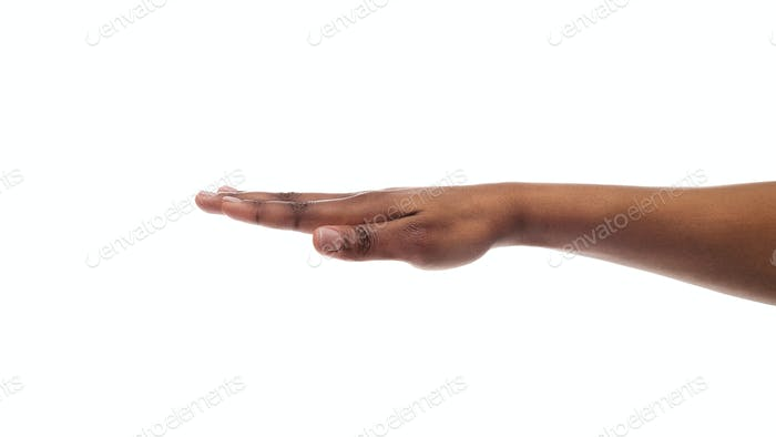 Outstretched black female hand isolated on white background
